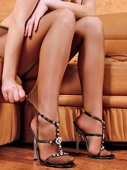 Cutie in control top tights teasing with her long legs in high heel sandals